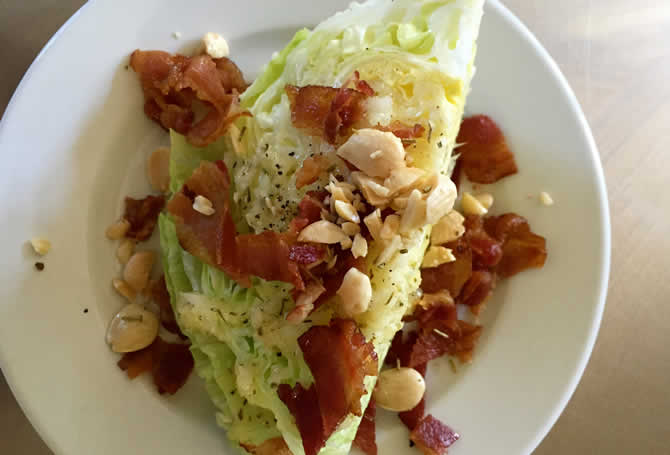 Iceberg wedge with Marcona almonds, bacon, and honey onion dressing